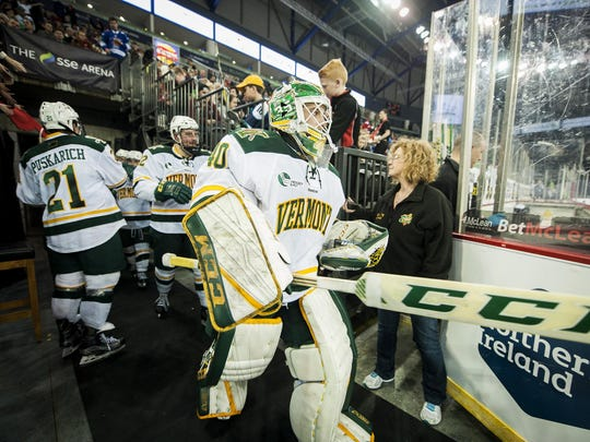 Vermont goalie Stefanos Lekkas (40) and the rest of the team take the ice before their game against UMass in the Friendship Four hockey tournament Nov. 25 in Belfast, Northern Ireland.