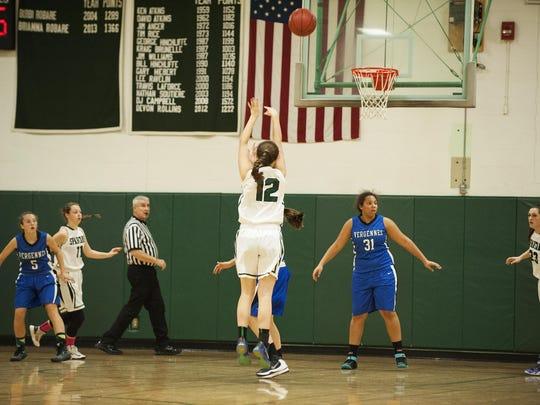 Winooski's Lydia Nattress (12) takes a shot during a high school girls basketball game last season.