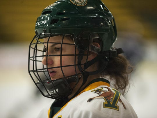 Catamounts forward Amanda Pelkey (21) during warm ups
