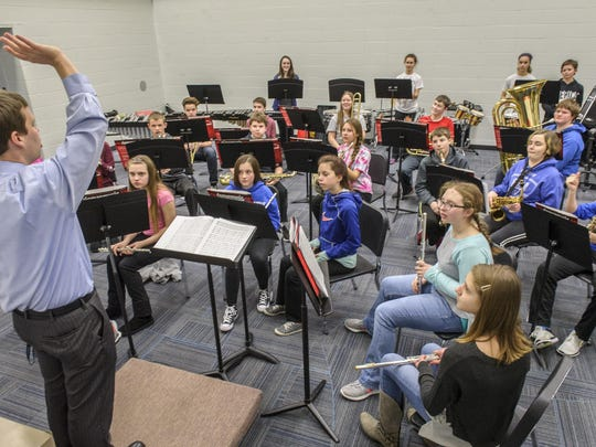 The Bondurant-Farrar middle school band has about 200 student musicians. The high school has about 80. High school band leader Braden Wipperman helps with the eighth-grade classes.