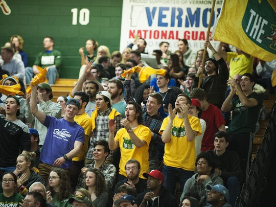 The Vermont student section cheers for the team during the men's basketball game between the Maine Black Bears and the Vermont Catamounts at Patrick Gym on Wednesday night February 1, 2017 in Burlington.