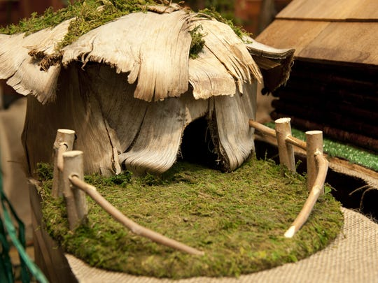"""""""Hobbit House"""" by Tom Butts was one of eight birdhouses in the live auction of Habitat for Humanity's eighth annual Birdhouse Auction at the Holiday Inn on Friday, May 3, 2013."""