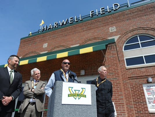 In this Tuesday April 18, 2017 photo,  Kirk Gibson, center, speaks of Detroit Tigers announcer Ernie Harwell as, from right, Alan Trammell, attorney Gary Spicer, and Wayne State baseball coach Ryan Kelley, as Wayne State University in Detroit unveiled Harwell Field, the school's baseball stadium named after Harwell.  (Max Ortiz/Detroit News via AP)