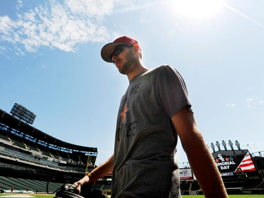 Boston Red Sox pitcher Chris Sale walks to the dugout before a baseball game against the Chicago White Sox, Monday, May 29, 2017, in Chicago. (AP Photo/Paul Beaty)