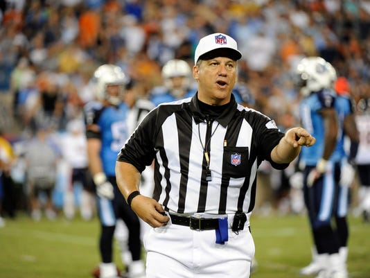 FILE - In this Aug. 27, 2011, file photo, referee Alberto Riveron makes a call in the second quarter of an NFL football preseason game between the Chicago Bears and the Tennessee Titans in Nashville, Tenn. Riveron has a difficult challenge, and he's taking it on at a pivotal time in the NFL. Riveron has stepped in this year as the league's chief of officiating, replacing Dean Blandino, who joined his predecessor, Mike Pereira, as an analyst at Fox.(AP Photo/Frederick Breedon, File)