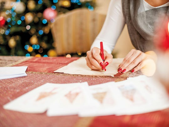 Woman Writing a Christmas Card on Table