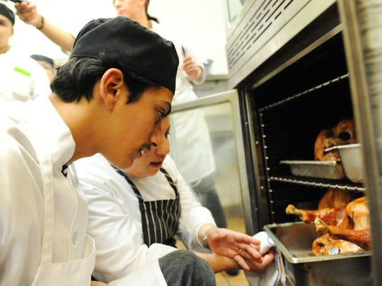 FILE: José Luis Luna León, a student at Rancho Cielo's Drummond Culinary Academy, listens to his instructor in this undated photo.