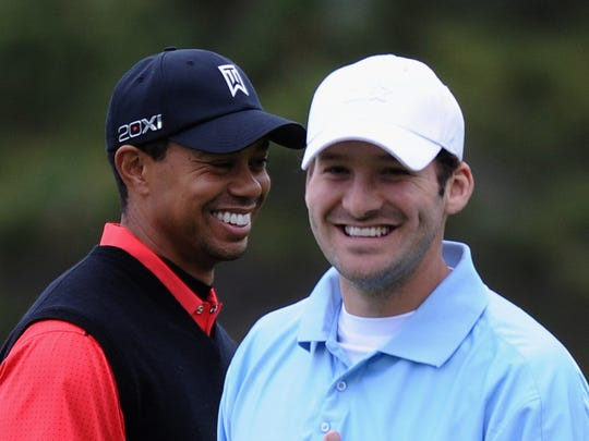 PEBBLE BEACH, CA - FEBRUARY 12: Tiger Woods (L) and Tony Romo (R), NFL football quarterback for the Dallas Cowboys, share a laugh on the fifth hole during the final round of the AT&T Pebble Beach National Pro-Am at Pebble Beach Golf Links on February 12, 2012 in Pebble Beach, California. (Photo by Harry How/Getty Images)
