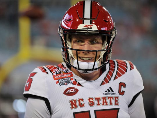 Dec 31, 2018; Jacksonville, FL, USA; North Carolina State Wolfpack quarterback Ryan Finley (15) warms up on the field prior to the game against the Texas A&M Aggies at TIAA Bank Field. Mandatory Credit: Adam Hagy-USA TODAY Sports