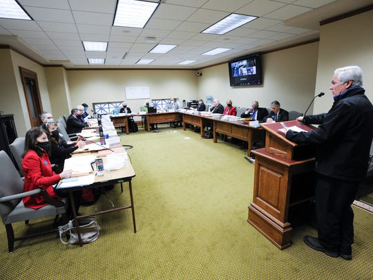 The Montana House State Administration Committee hears testimony on a bill seeking to revise the state's disaster and emergency services and executive power Tuesday at the State Capitol in Helena, Mont.