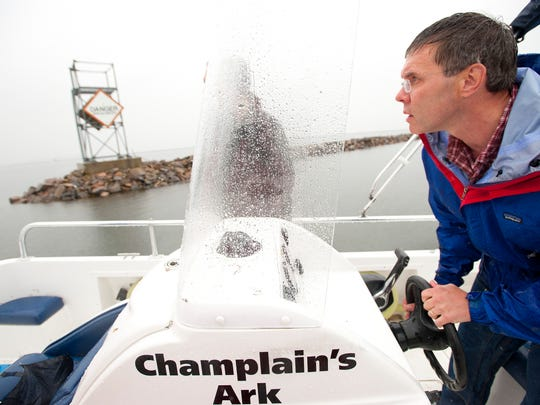 James Ehlers, executive director of Lake Champlain International, maneuvers Champlain's Ark, a free sewage pumping vessel for boats on Lake Champlain, around the breakwater on the Burlington Waterfront on Tuesday, June 11, 2013.