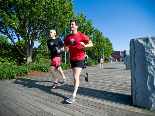 Mayor Miro Weinberger, right, goes for a run with assistant Mike Kanarick by the Burlington waterfront.