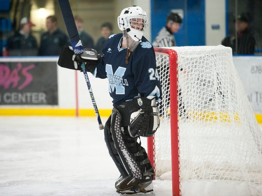 Mount Mansfield's Fiona-Rose Dulude tends goal during a high school girls hockey game last season.