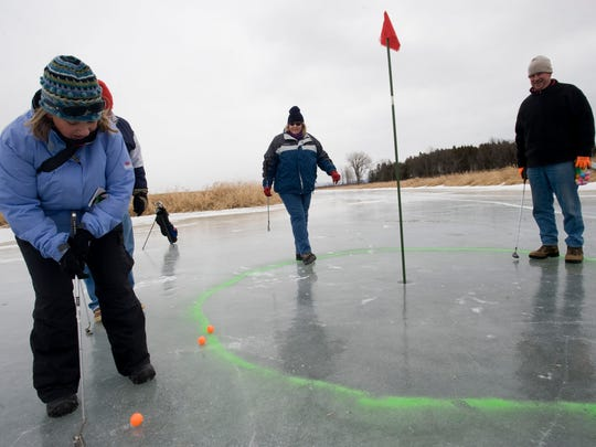 Ice golfers play a round on frozen Lake Champlain in North Hero during the Great Ice event in 2010.