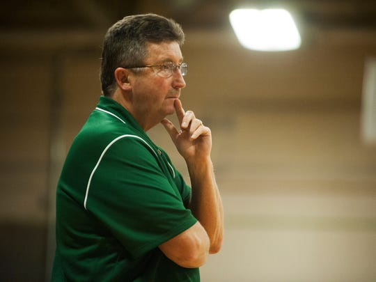 Rice's Tim Rice, seen coaching earlier this season, collapsed and was revived on scene at the Division I girls basketball semifinals at Patrick Gym on Saturday night.