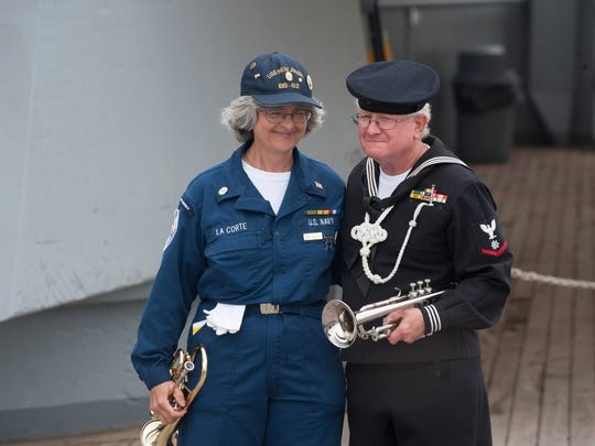 Bertrand Trottier, the last U.S. Navy Bugler, USS New Jersey Veteran during the Vietnam War, and the ships current bugler Nan LaCorte share a moment following Taps during the 71st Anniversary of the first commissioning of the USS New Jersey into the U.S. Navy. Friday, May 23, 2014.