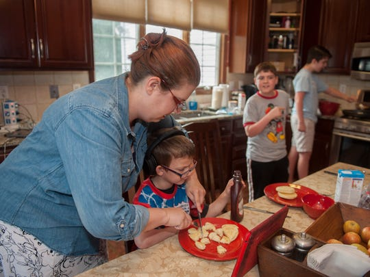 Malaga resident Meg Falciani prepares breakfast for her five children who all have food allergies.  Thursday, June 26, 2014.
