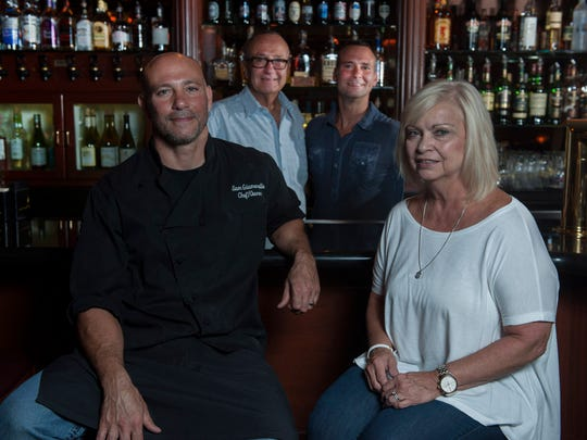 The Giumarello family (clockwise from top left) Sam Sr., Gian, Rosemary, and Sam Jr. have been in the restaurant business together for 25 years. Giumarello's routinely offers nightly specials, such as soft shell crabs with crab and corn risotto (above).
