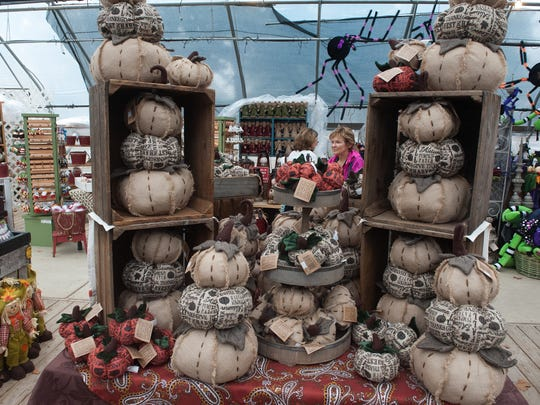 A large selection of harvest fall items displays at the Johnson Farms in Medford during the Fall Harvest Festival.