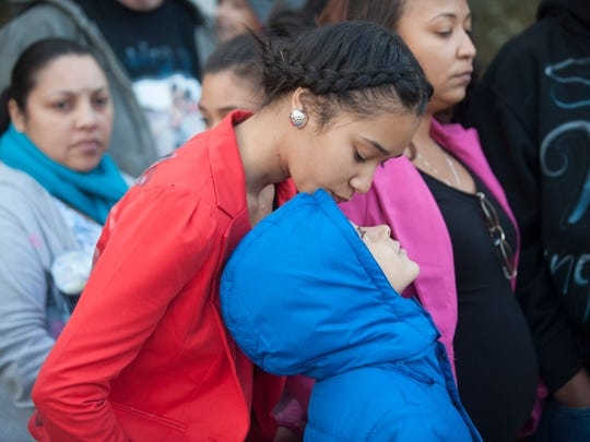 Amber Andujar looks down at a family member as her mother speaks to the media following the sentencing of Osvaldo Rivera.
