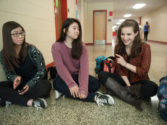 Cherry Hill East High School students (L to R) Monica An, Katy Kim and Madlyn Kates talk about their views on diversity and race. Tuesday, October 14, 2014.