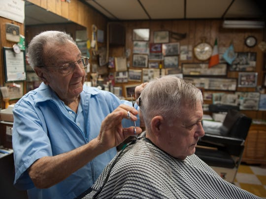 Frank Anello, 90, runs the barbershop his father opened in 1924 — the year Frank was born. Barber Frank Anello Jr., 90, cuts Bill Hagan, 80, of Gloucester City, at Anello's Barbershop in Gloucester City. Hagan has been going to Anello's Barbershop for 75 years. Tuesday, December 23, 2014.
