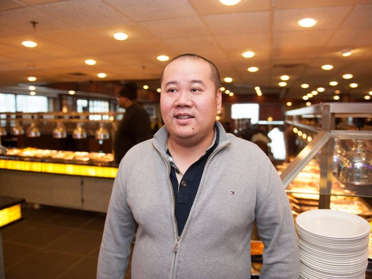 Zhenghai Zheng, co-owner of Ichiban Buffett in Chery Hill for storefront. Wednesday, January 7, 2014.