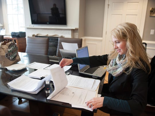 Caroline Miller, settlement officer with Surety Title Company, holds a closing at Kings Hall coworking space in Haddonfield.