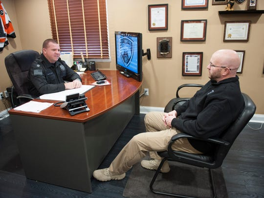 Outgoing Westampton Police Chief Rick Smith (RIGHT) talks with incoming chief, Captain Joseph Otto. Wednesday, January 21, 2015.