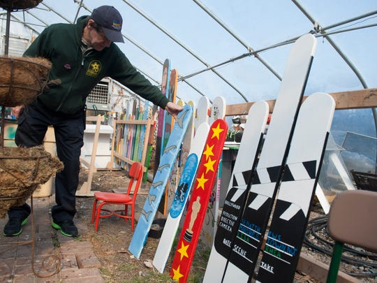 Mike Devlin, executive director of the Camden Children's Garden, shows some of pieces for this year's Hollywood themed Philadelphia Flower Show. Here, fence boards painted by local students continue the Hollywood theme. Friday, February 20, 2015.