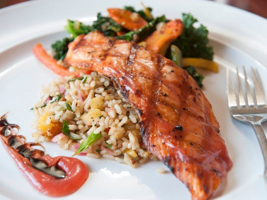Strawberry citrus salmon is served with island rice and fruit at Kitchen 519 in Glendora.
