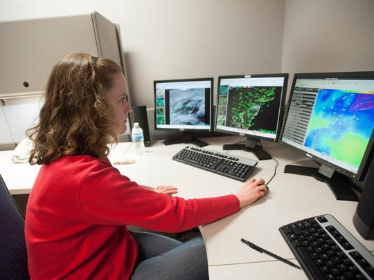 Kristin Kline, a meteorologist with the National Weather Service, works on the short-term forecast for the region.