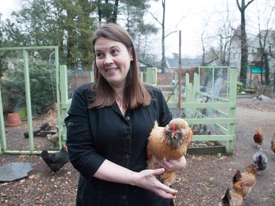 Woodbury resident Jessica Ferguson tends to her chickens in the back yard of her home. Council must decide if it wants to grant Jessica Ferguson — a responsible owner of 14 chickens — a use variance for her property or amend its city ordinance to allow it for everyone. Friday, March 27, 2015.