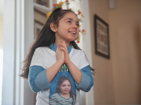 Tatyana (aka Tuffy) Rivera smiles as she listens to a song at her home in Camden County. Tuffy has severe epilepsy, but has progressed greatly since she started taking medical marijuana. She is now able to feed herself and say a few words. Thursday, April 2, 2015.