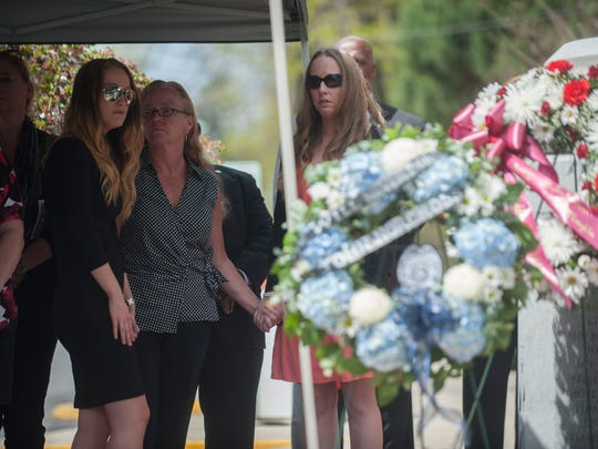 The family of Jack McLaughlin (L to R) including his daughter Victoria, wife Kim and daughter Kirsten look on as the wreaths are layed at the memorial on Station Ave. in Haddon Heights in remembrance of the 20th anniversary of the McLaughlin-Norcross shootings. Monday, April 20, 2015.