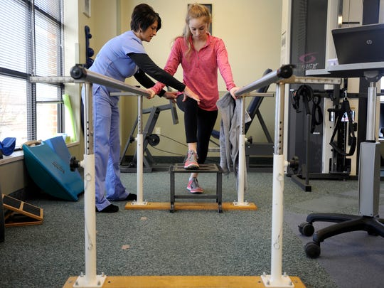 Payton Reuter, 17, an 11th-grader at Piketon High School works with Adena Rehabilitation and Wellness Center physical therapist Lisa Cunningham on Wednesday. Reuter tore her ACL for a second time but is planning to be ready to play volleyball next season.