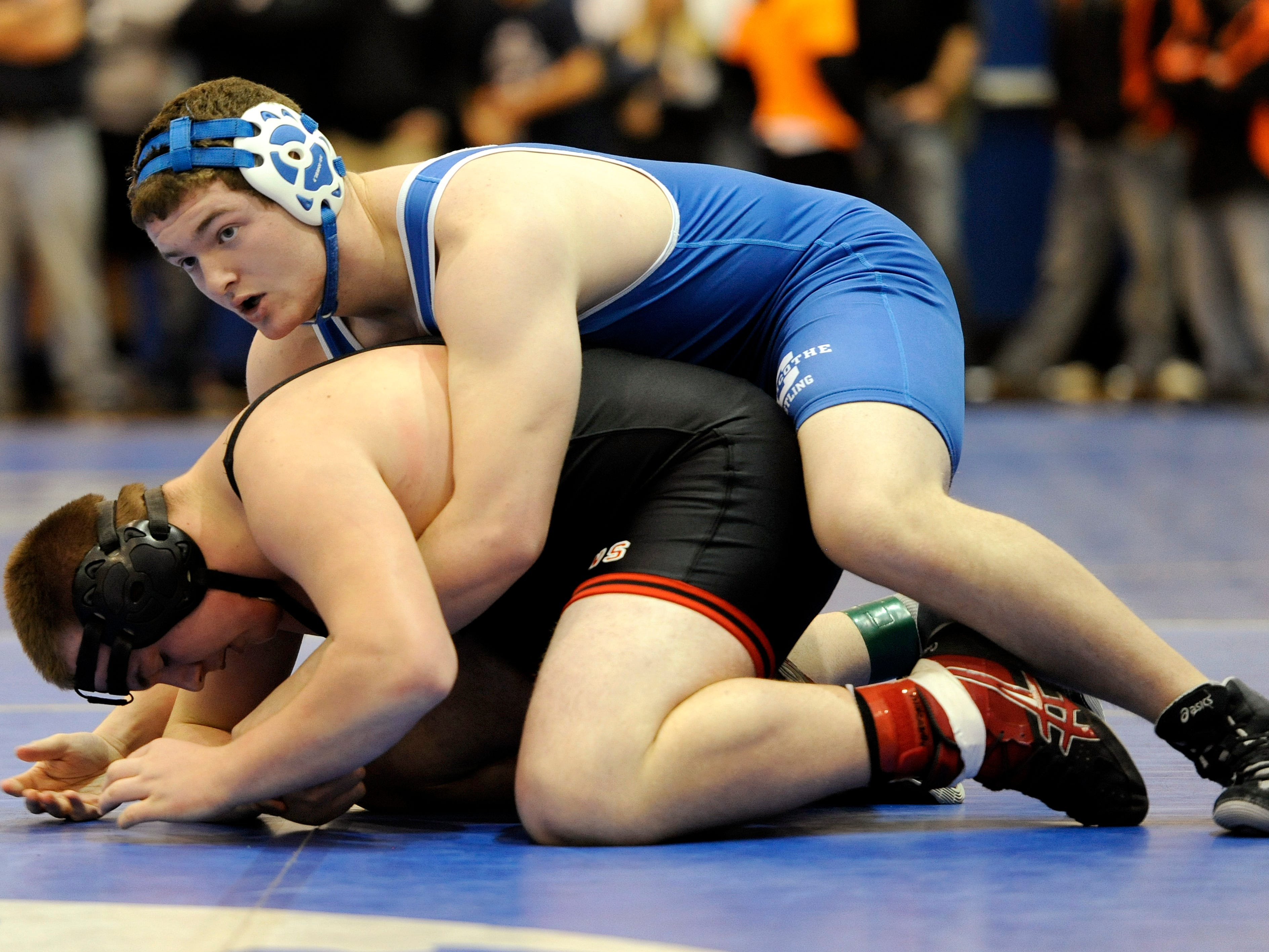 Chillicothe's Austin Mathis wrestles New Richmond's Justin Noble in the 220 pound weight class during the Division II district wrestling tournament at Southeastern High School, March 7.