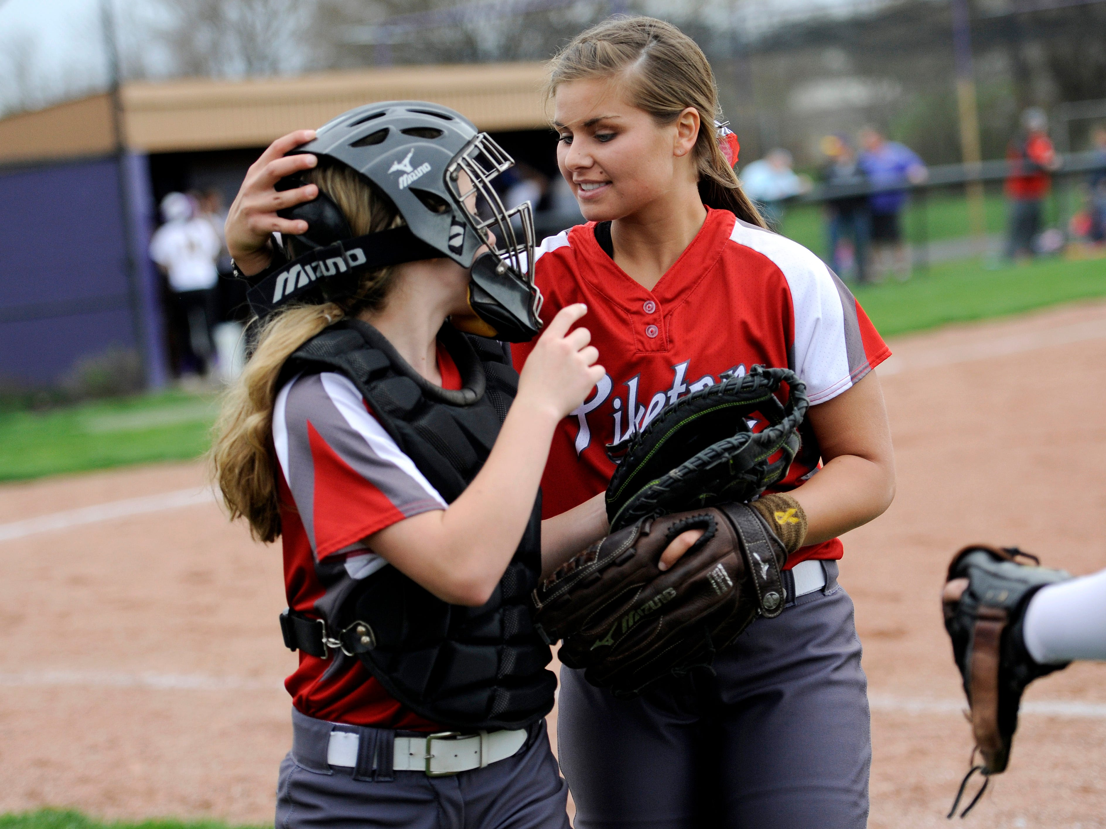 Piketon pitcher Adrien Dunn, right, talks to catcher Madi Conley after an inning during the game at Unioto on Wednesday. Piketon won, 8-1.