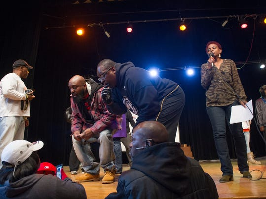 Michael Brown Sr., the father of Michael Brown, on stage with Demetrious Johnson while taking part in the Demetrious Johnson Charitable Foundation 23rd annual holiday food giveaway on Saturday.