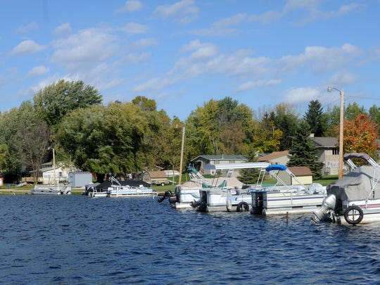The view from Long Lake at some of the docks and houses in Chinatown.
