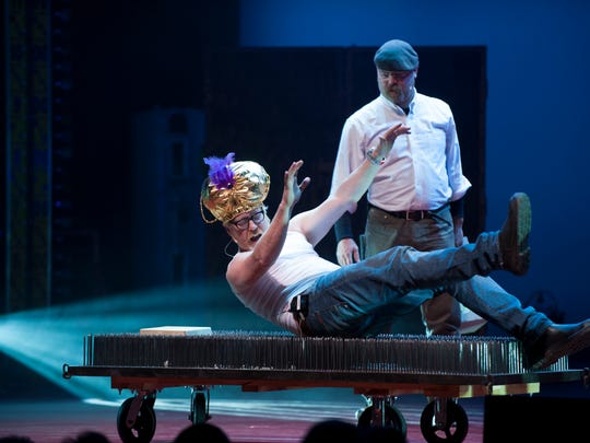 """MythBusters"" hosts Adam Savage (left) and Jamie Hyneman put a bed of nails to the test in their touring show."