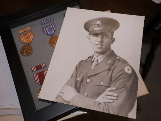 A picture of Jack Bauknecht, 89, of Delta Township,  and medals from his World War II days Thursday  11/6/2014.   Bauknecht, an MP, ended up guarding German POW's among other missions.    (Rod Sanford | Lansing State Journal)