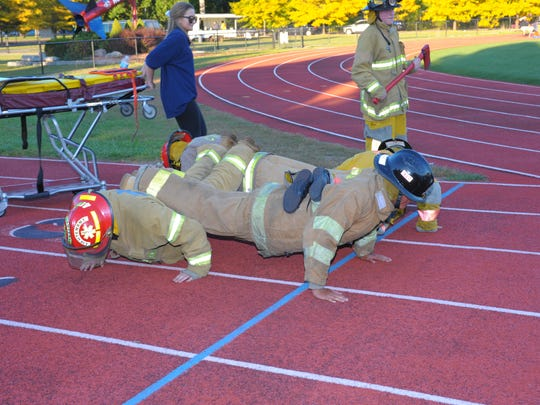 William D. Ford Career-Technical Center's EMT students show off their athletic skills during the parade.