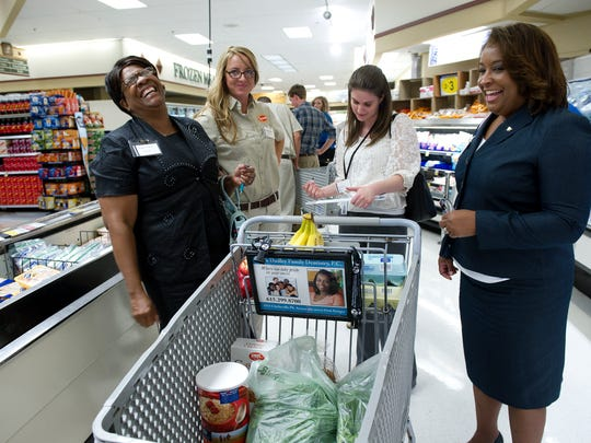 Minnie Mitchell, left, Anna Davenport, Allison Thigpen and LaTrisha Jemison participated  in a challenge in which they buy food for a fake family of four using the equivalent of federal benefits. (File)