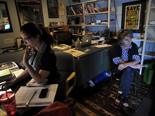 Belcourt Theatre Education and Engagement Director Allison Inman, left, and Marketing and Development Director Cindy Wall work in the upstairs offices of the Hillsboro Village movie house.