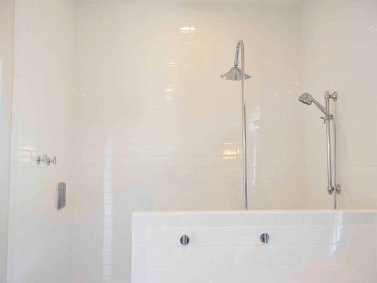 One of Bassham's favorite things about his new home is his master bath shower.