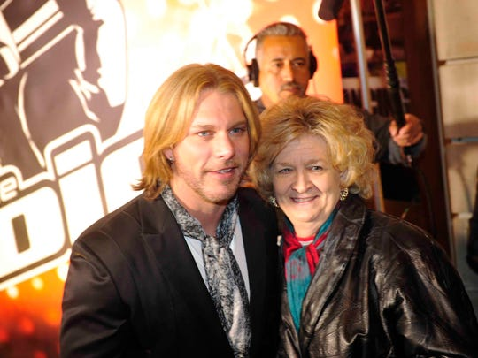 Craig Wayne Boyd gets his picture made with fan Carolyn Padula of Nashville before playing a show at the Wildhorse Saloon in downtown Nashville.
