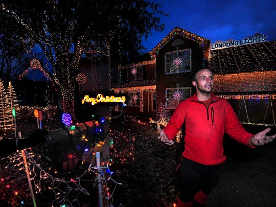 Old Hickory resident Brad Henn puts the finishing touches on his 28,000 Christmas lights this year. The lights are in honor of his daughter, London, who died in 2012. The family also collect toys for the Monroe Carell Jr. Children's Hospital at Vanderbilt.