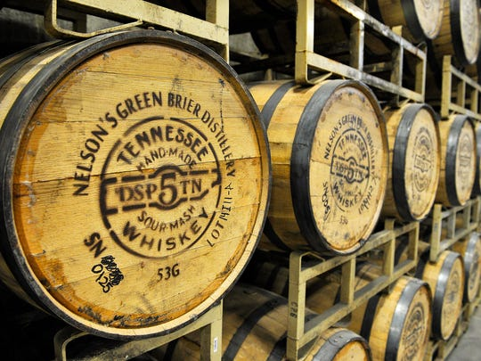 White oak barrels hold whiskey at the Green Brier Distillery