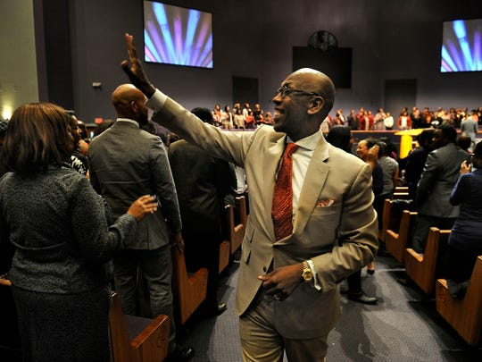Mt. Zion Baptist Church Bishop Joseph Warren Walker III greets worshippers Sunday in Nashville. The leader of the 29,000-member church struggled with God while his wife was dying of cancer about 10 years ago.
